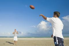 Stock Photo of Multi-ethnic men playing catch