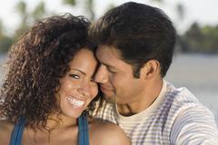 Stock Photo of Hispanic couple hugging