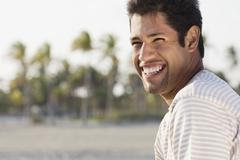 Hispanic man laughing Stock Photos