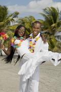African man carrying wife Stock Photos