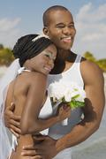 African bride and groom hugging Stock Photos