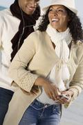 Multi-ethnic couple listening to mp3 same player Stock Photos