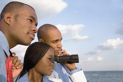 African businesspeople looking through binoculars Stock Photos