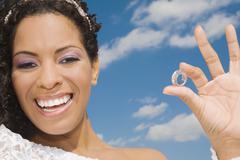 Stock Photo of Hispanic bride holding ring