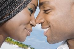 African couple smiling at each other Stock Photos