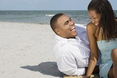 African couple laughing at beach Stock Photos