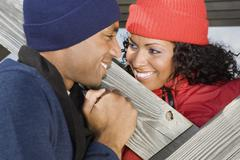 Stock Photo of Multi-ethnic couple smiling at each other