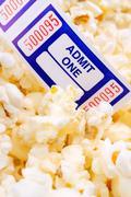 Movie Ticket and Pop Corn Stock Photos