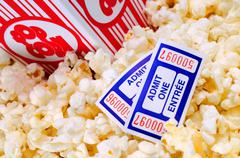 Movie popcorn and tickets Stock Photos