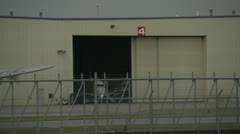 Aircraft, Boeing B17 idle taxi past hangar Stock Footage