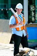surveyor with plans - stock photo