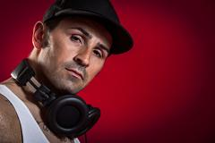 dj in front of a red background - stock photo
