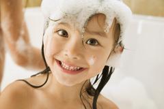 Asian girl in bubble bath Stock Photos