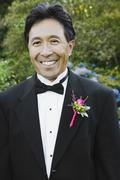 Asian man with boutonniere on lapel - stock photo