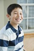 Close up of Mixed Race boy smiling - stock photo