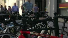 People walking by bike rack, urban Stock Footage