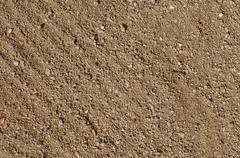 Textured gravel sand background Stock Photos