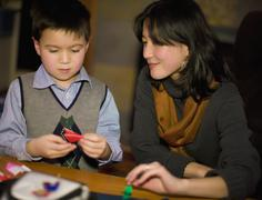 Asian mother and son making origami Stock Photos