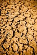 cracked mud arid ground - stock photo
