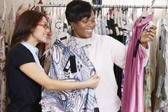 Multi-ethnic women clothes shopping Stock Photos