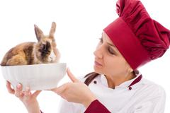 Chef with dwarf rabbit inside a bowl Stock Photos