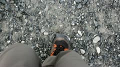 Hiker walking on gravel Stock Footage