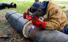 Stock Photo of Welder Working on Metal Tubes