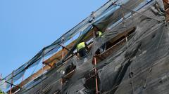Workers on Scaffolding - stock photo