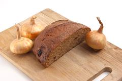 Rye bread and onions Stock Photos