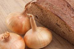 rye bread and onions - stock photo