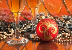 glasses of wine and christmas decoration - stock photo
