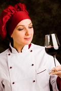 chef somelier with wine - stock photo