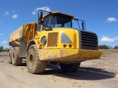 giant quarry construction dump truck - stock photo