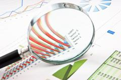 Stock Photo of magnifying glass and with a diagram