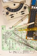 multimeter on  wiring diagram - stock photo
