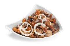 Salad with marinated mushrooms and onions Stock Photos