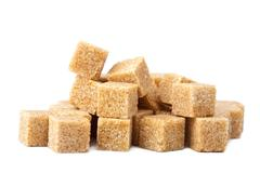 Stock Photo of cane sugar cubes isolated
