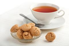 Muffins and cup of tea Stock Photos