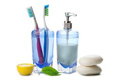 soap and toothbrushes isolated - stock photo