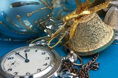 christmas decoration and pocket watches - stock photo
