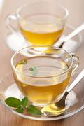 Stock Photo of two cups of green tea with mint
