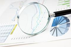 Stock Photo of magnifying glass and the working pape