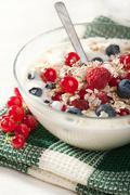 yoghurt with cereal and wild berries - stock photo