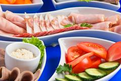 Assorted sausages and vegetables Stock Photos
