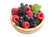 fresh berries in wood bowl isolated - stock photo