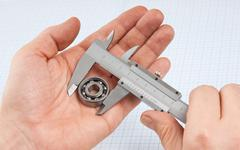 Callipers with bearing in hand Stock Photos