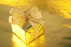 golden gift box with bow - stock photo