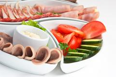 Stock Photo of assorted sausages and vegetables