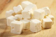 feta cheese on wooden cutting board - stock photo