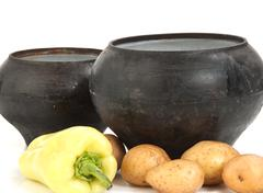 cast iron pot with vegetables - stock photo